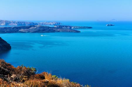 Beautiful landscape with sea view. Cruise liner at the sea near the Nea Kameni, a small Greek island in the Aegean Sea near Santorini, cyclades, Greece