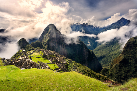MACHU PICCHU, PERU - MAY 31, 2015: View of the ancient Inca City of Machu Picchu. The 15-th century Inca site.Lost city of the Incas. Ruins of the Machu Picchu sanctuary. UNESCO World Heritage site.