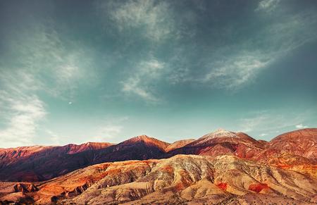Cerro del los Siete Colores. Colored mountains. Hill of Seven Colors over Purmamarca village. Quebrada de Humahuaca valley, and UNESCO World Heritage Site, Argentina