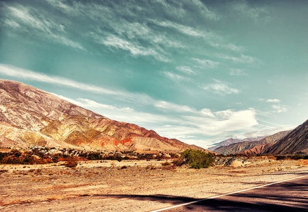 Cinematic road landscape. Humahuaca valley, Altiplano, Argentina. Misty road. Stock Photo