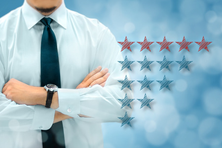 evaluate: Quality, performance review, evaluation and classification ranking concept. Businessman silhouette in background. Stars icons in the foreground. Stock Photo