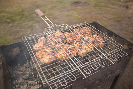 Bbq with chicken. Delicious chicken on the grill. Belarus