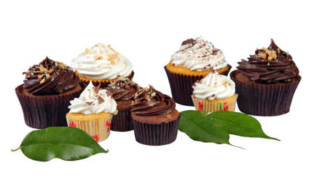 eight cookies in baskets and three leaves on a white background in low angle Standard-Bild