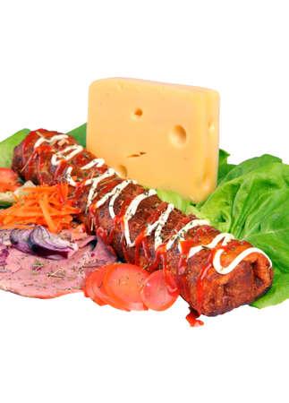 meat, cheese, lettuce, onion, carrot, tomato on white background, detail Standard-Bild - 107767423
