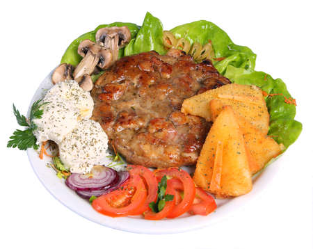 Hamburger on a platter with cheese, tomatoes, mushrooms, onions and lettuce Standard-Bild