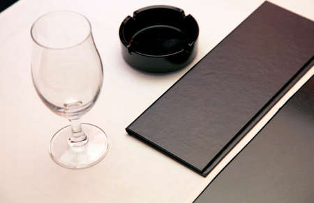 restaurant features: glasses, ashtrays, meny unmarked on the table