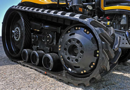 new black excavator outside with rubber crampons