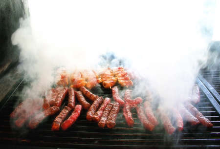 Rolled meat on the grill with smoke Standard-Bild