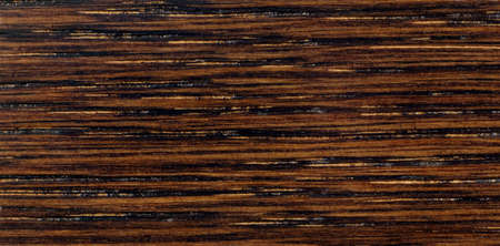 Dark brown wood texture with stripes, pattern for furniture industry Standard-Bild