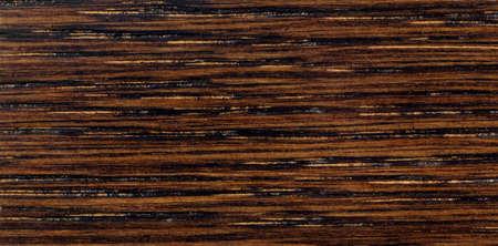 Dark brown wood texture with stripes, pattern for furniture industry Standard-Bild
