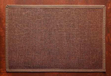 Knitted decorative brown background, with brown frame on brown table