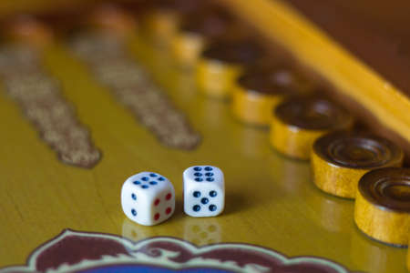 Dices set.Play backgammon table game.Rolling dice in old board game.