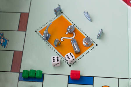 Cubes with the game monopoly on the table.