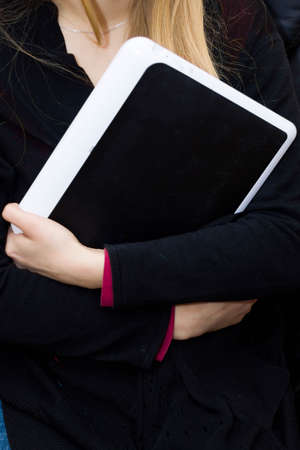 Portrait of cute sad girl with digital tablet. Imagens