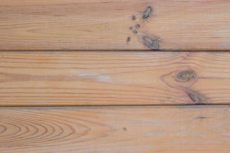 Wooden background of medium density fiberboard close-up.