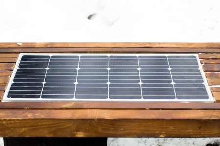 Bench with solar panel on street close-up