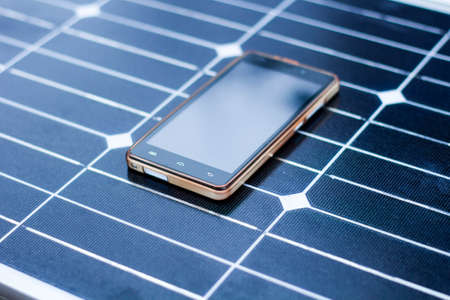 mobile phone on a solar panel outdoor close up Banque d'images