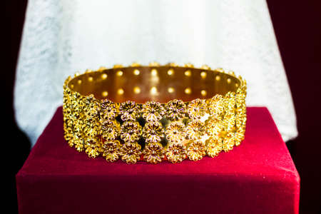 Gold and jewell-studded Kings crown close-up in the gallery Stock Photo