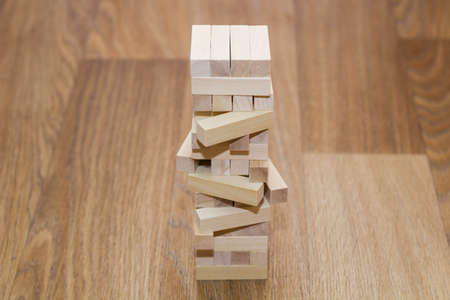 Wood block tower game on white background