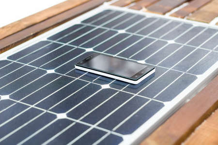 mobile phone on a solar panel outdoor close up 스톡 콘텐츠