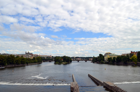 insipid: Vltava River in Prague summer cloudy day