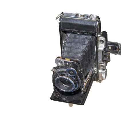 The ancient camera-is isolated on the white Stock Photo