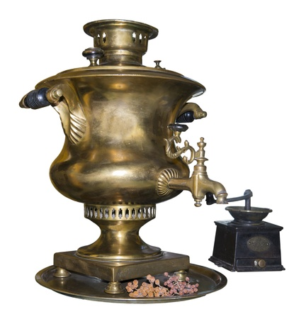 Samovar and coffee grinder is made in 1901-is isolated on the white photo