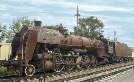 Rusty steam locomotive in Rostov-on-Don photo