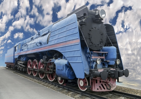 The blue express steam locomotive which is accelerating momentum 125 kmhour Stock Photo