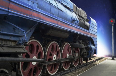 The blue express steam locomotive which is accelerating momentum 125 km hour photo