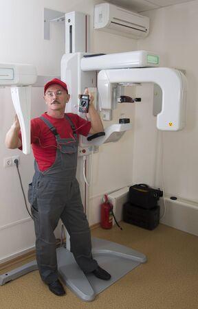 lighting technician: The technician repairs Digital Panoramic X-ray Sistem