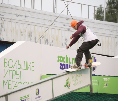 Rostov-on-Don, Russia, September 26, 2013 - The athlete jumps on a snowboard on a holiday company Megafon September 14, 2013 in Rostov-on-Don Editorial