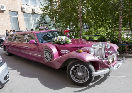ROSTOV-ON-DON, RUSSIA-SEPTEMBER 21 - Beautiful car decorated with flowers for the wedding in Rostov-on-Don on September 21, 2013 in Rostov-on-Don