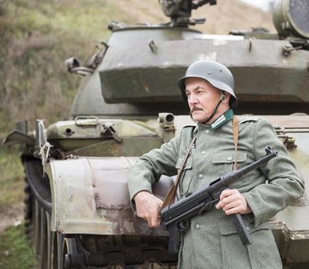 Man in uniform German soldier WW II with a gun Schmeisser Stock Photo