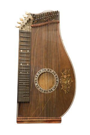Zither-traditional a German musical instrument. The beginning of 19 centuries.Is isolated on the white