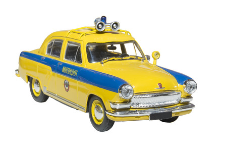 Miniature model police car - is isolated on the white Stock Photo