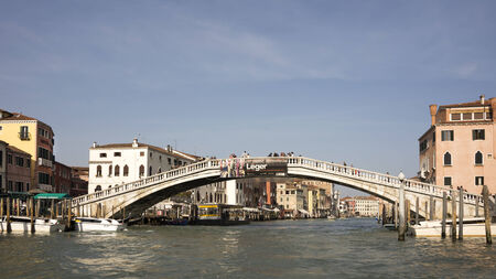 working stiff: Venice, Italy, March 30, 2014: Tourists walk on the bridge Scalzi