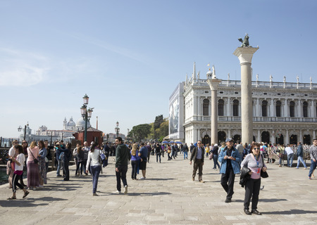 Venice, Italy- March 30, 2014:Tourists walk on the Piazza San Marco
