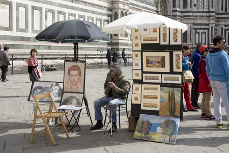 expects: Florence, Italy-April 01, 2014:Street artist expects walking around tourists