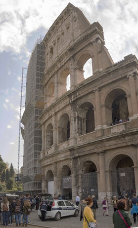 Rome, Italy- April 02, 2014:Tourists visiting the Coliseum (started to build in 72 AD under Vespasian, and in 80 AD amphitheater was consecrated by Titus