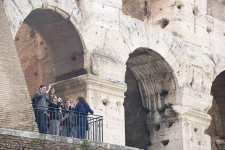 consecrated: Rome, Italy- April 02, 2014:Tourists visiting the Coliseum (started to build in 72 AD under Vespasian, and in 80 AD amphitheater was consecrated by Titus)