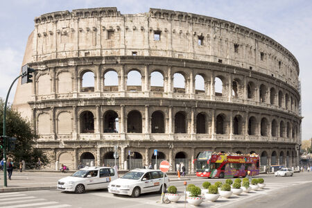 Rome, Italy- April 02, 2014:Tourists visiting the Coliseum (started to build in 72 AD under Vespasian, and in 80 AD amphitheater was consecrated by Titus)