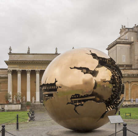 Golden Globe by sculptor Arnaldo Pomodoro at the Court of Pines. Vatican. Italy