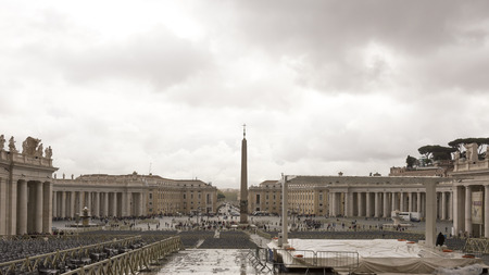 st  peter's square:  Vatican,Italy-April 04,2014: Tourists visiting St. Peters Square