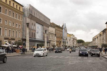 st peter s square:      Vatican,Italy-April 04,2014: Pedestrians and vehicles move along the Via della Conciliazione (Road of the Conciliation)   Editorial