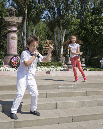 theorist:   ROSTOV-ON-DON,RUSSIA-JULY 27- Talented children sing in celebration of the Navy at the monument to Admiral Ushakov on July 27,2014 in Rostov-on-Don