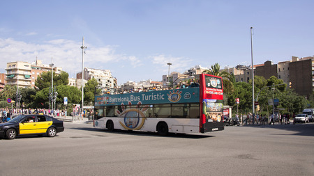 Barcelona,Spain-September 9,2014 : Tourists visiting Barcelona on foot and with a tourist bus