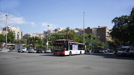 taxi famous building: Barcelona,Spain-September 9,2014 : Tourists visiting Barcelona .Cars moving around town