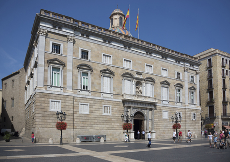 generalitat: Barcelona,Spain-September 9,2014 :Tourists and the guards at at the Palace of the Generalitat ( Palau de la Generalitat) Editorial