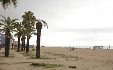Santa Susanna,Spain-September 17,2014: Tourists walking and sunbathing on the beach